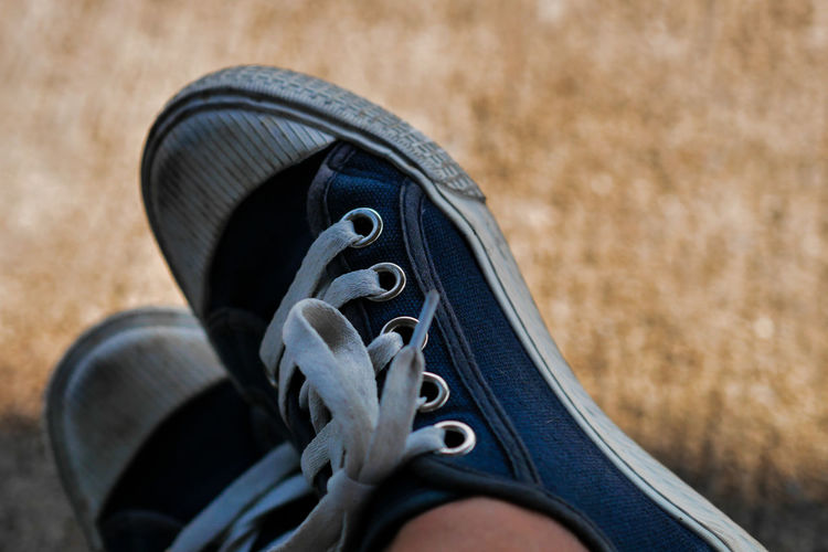 Low section of person wearing shoes