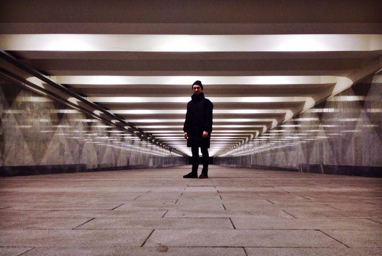 Man standing at illuminated basement