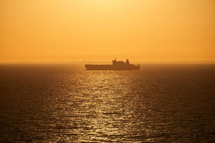 Sea Water Nautical Vessel Sky Sunset Transportation Waterfront Scenics - Nature Mode Of Transportation Horizon Over Water Horizon Beauty In Nature Orange Color Tranquility Tranquil Scene No People Nature Ship Sailing Outdoors Passenger Craft Cruise Ship