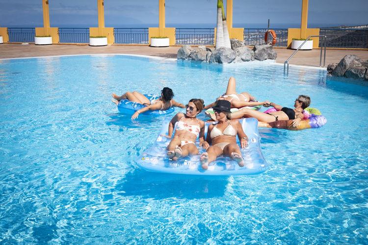 Women by swimming pool
