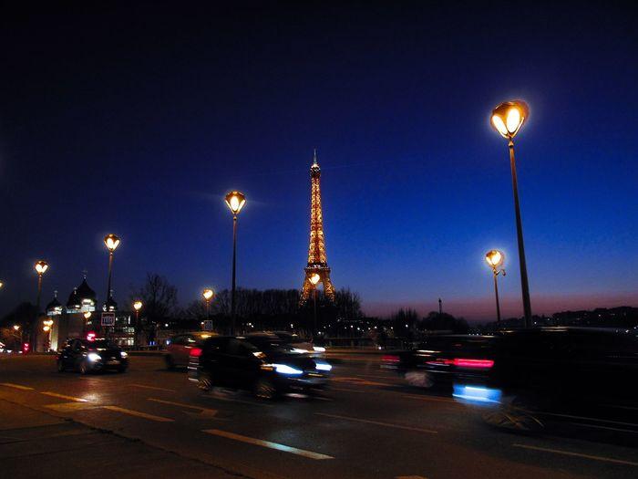 What a view Eye Em Travel Eye Em Around The World Eiffel Tower Paris Lights Illuminated Night Street Light Lighting Equipment Sky Car Architecture Outdoors City