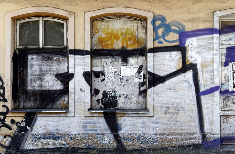 Hittite Abandoned Architecture Building Building Exterior Built Structure City Communication Day Deterioration Glass Glass - Material Graffiti Mural No People Old Outdoors Text Transparent Wall Wall - Building Feature Western Script Window