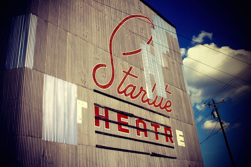 Architecture Blue Cinema Clouds Day Drive-in Drive-in Theater Exceptional Photographs Cinema In Your Life Film Metal Metallic Movie Theatre  Movies No People Old Outdoors Sign Sky Starlite Structure Town Vintage Wall Wires