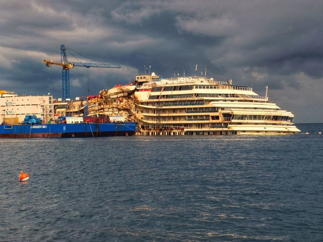 Isola del giglio Naufragio Concordia Business Finance And Industry Sea Ship Nautical Vessel Industry Freight Transportation Sky Building Exterior No People Architecture Outdoors Day Harbor City Water Cityscape Be. Ready.