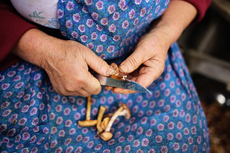 Working hands never get depression Senior Adult One Person Senior Women Human Hand Real People Close-up Holding Knife Mushrooms Working Working With Hands Leisure Activity Cooking Blue Women Depression Work Storytelling Country Healthy Eating Healthy Food Healthy Cooking EyeEm Best Shots