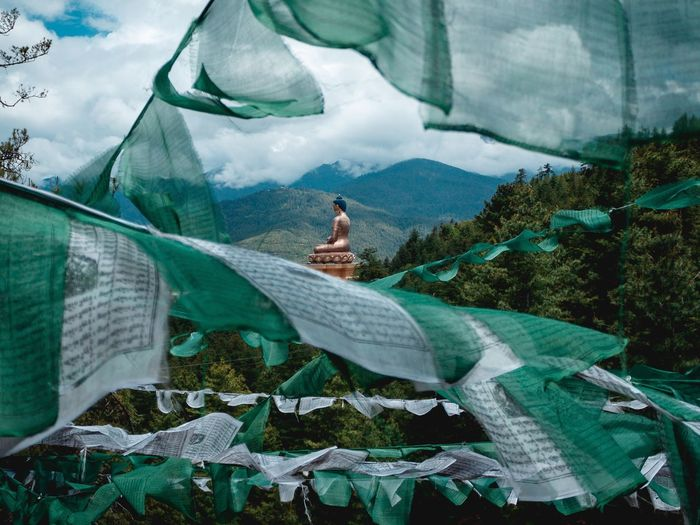 Flags against buddha statue
