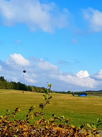 Sky Blue Nature Flying Cloud - Sky Outdoors Beauty In Nature Hot Air Balloon Horizontal Landscape Day Tranquility No People Scenics Tree Wind AirPlane ✈ Aerospace Industry Skyjump Capturing Motion