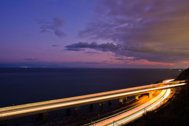 Sky Illuminated Transportation Cloud - Sky Night Road Long Exposure Light Trail Motion Speed Sunset Blurred Motion City Nature Architecture Street Dusk Highway Sea No People Horizon Over Water Outdoors Bridge - Man Made Structure Multiple Lane Highway Ocean View