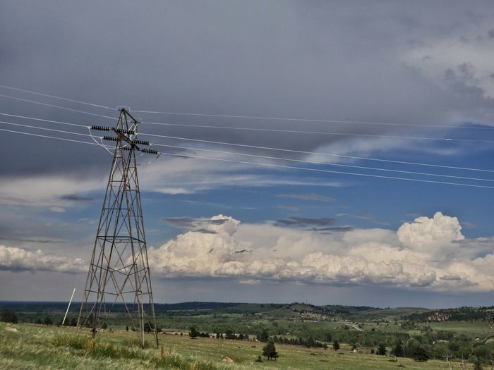 Electricity  Technology Electricity Pylon Cloud - Sky Cable Landscape Steel Sky No People Day Fuel And Power Generation Tranquility Storm Cloud Grass Rural Scene Nature Wind Power Outdoors Power Station Beauty In Nature Electric Grid Powerlines Power Line  Electricity  Nature