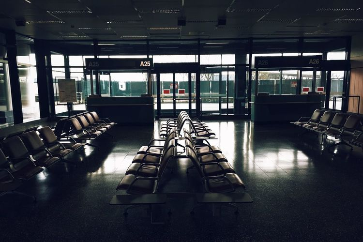 Empty Places Airport MalpensaAirport Gloomy Empty Chairs Natural Light