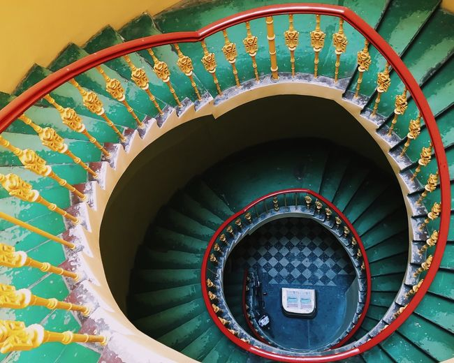 Directly above shot of spiral staircases in building
