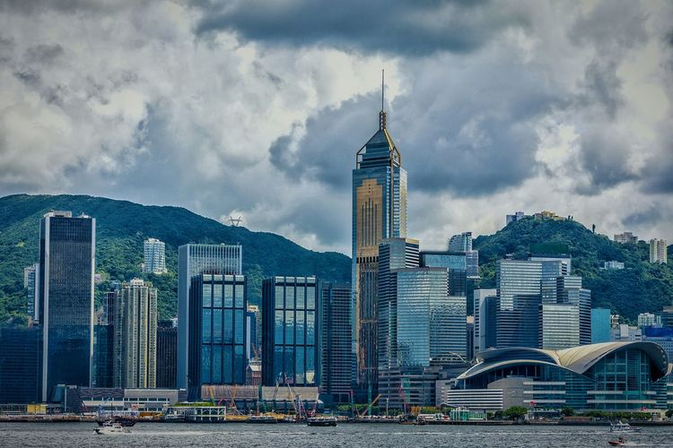 Architecture Skyscraper Cloud - Sky Building Exterior Sky Built Structure Tower Cityscape Travel Destinations City Urban Skyline Modern No People Outdoors Hong Kong Exceptional Photographs EyeEm Gallery Master Class Shape And Pattern Hong Kong Harbour Boats And Clouds