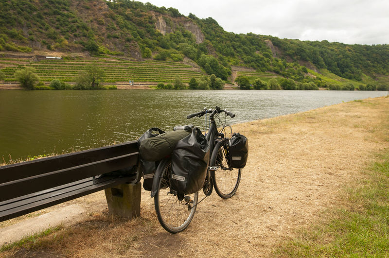 travelling at bike Bench Refreshment Travelling Beauty In Nature Bicycle Bike Bags Day Environment Grass Hill Landscape Mountain Nature Plant River Scenics - Nature Sky Summer Water