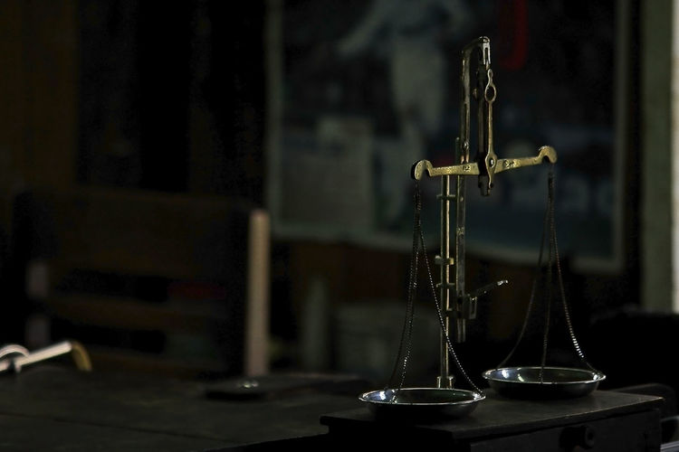 Close-up of weight scale on table in courtroom