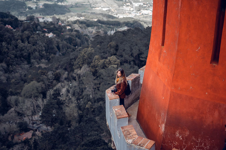High angle view of woman standing in balcony