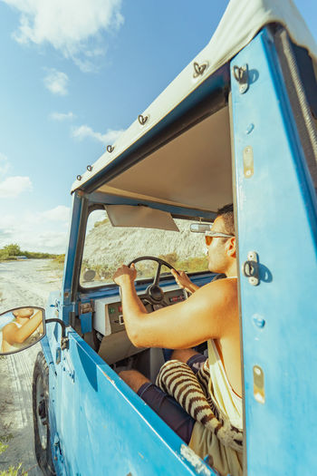 Portrait of woman sitting on boat against sky