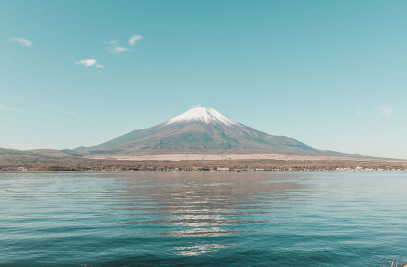 Mountain Sky Fuji Fujiyama Mount FuJi Mount Fuji Views In The Distance Beauty In Nature Scenics - Nature Water Waterfront Tranquility Tranquil Scene No People Non-urban Scene Nature Blue Volcano Day Travel Destinations Land Copy Space Lake Mountain Peak Turquoise Colored Snowcapped Mountain