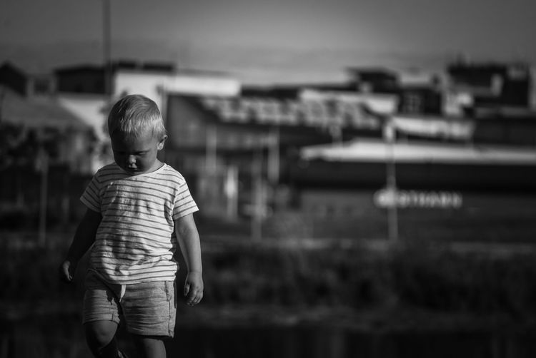 Boy standing against houses