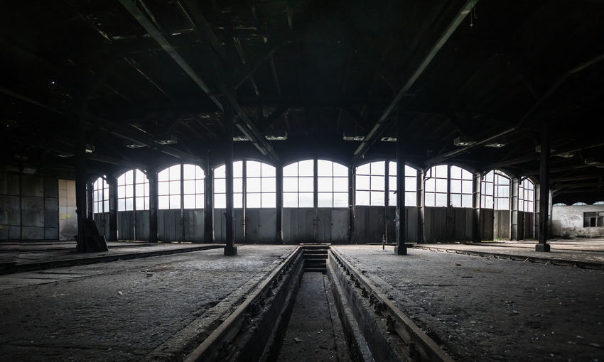 Abadoned Abandoned Abandoned Places Absence Architectural Column Diminishing Perspective Empty Engine Shed Illuminated Interior Lokschuppen Lost Places Public Transportation Rail Transportation Railroad Track Urban Urbanphotography Urbex Vanishing Point
