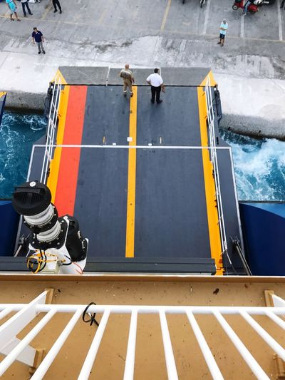 High angle view of men standing on ship