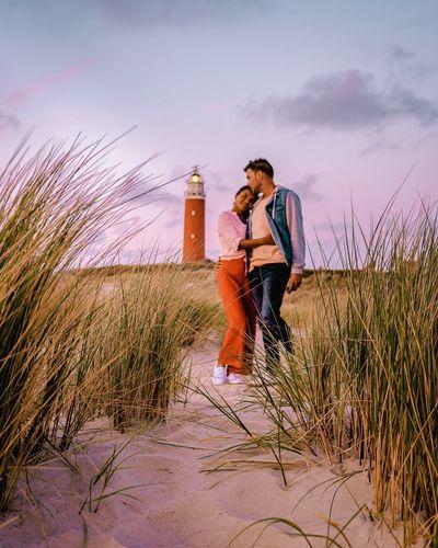 Agameoftones Man Texel  Lighthouse Netherlands Colorfullife Fashionstyle Couple Couple Travelling Men Oudeschild Travel Couple Urbanfashion Full Length Young Women Women Standing Motion Portrait Drink Rural Scene Sky Casual Clothing Self Portrait Ear Of Wheat Countryside Denim Jacket Denim Pixelated Barley
