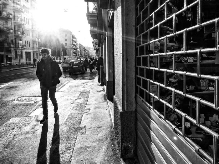 Full length of people walking on city street