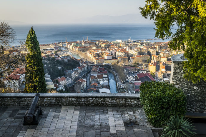 City of Rijeka view from Trsat, Kvarner bay of Croatia. View from above on the city and harbor of Rijeka, Croatia. Croatia From Above  Harbor Mobility In Mega Cities Rijeka Travel Architecture Building Exterior Built Structure City Cityscape Day High Angle View Kvarner Bay Nature No People Outdoors Roof Sea Sky Tourism Town Tree Trsat Water