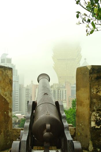 History Weapon Cannon Military Modern Peace Highrisebuilding Today. マカオ 昔 歴史 現代 大砲 高層ビル ちぐはぐ