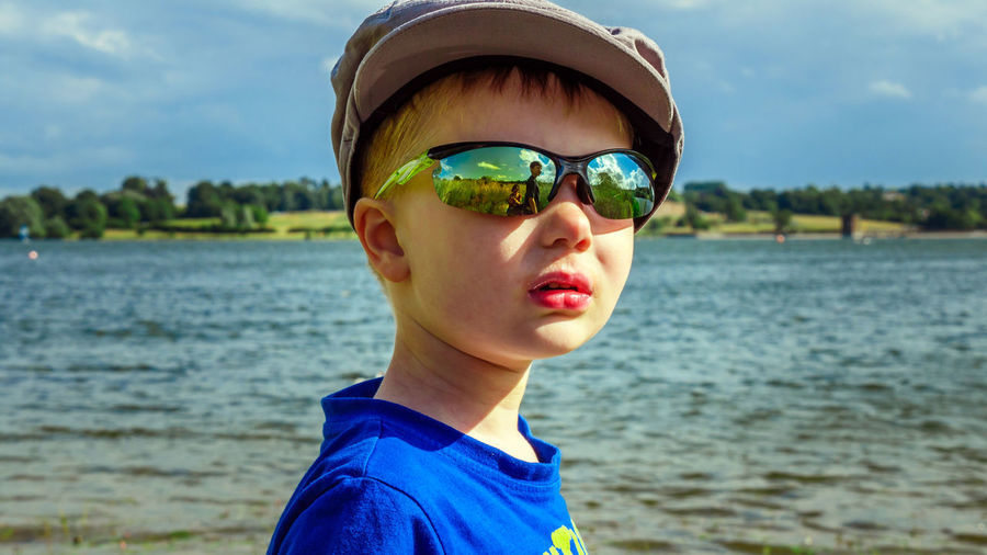 Family Landscape Park Picnic Pitsford Walk Water Headshot Portrait One Person Leisure Activity Real People Childhood Day Focus On Foreground Child Boys Lifestyles Glasses Nature Sunglasses Fashion Outdoors Innocence 2016 Picnic Lake Glasses Reflection