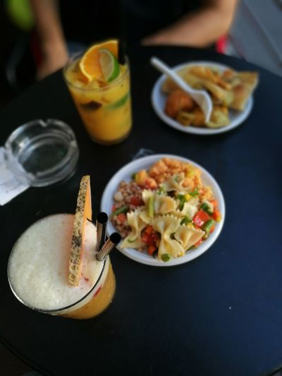 Happy Hour Analcolic Analcolico Aperitivo  Close-up Drink Drinking Drinking Glass Food Food And Drink Fruit Drink Healthy Eating High Angle View Plate Ready-to-eat Real People Refreshment Serving Size Table