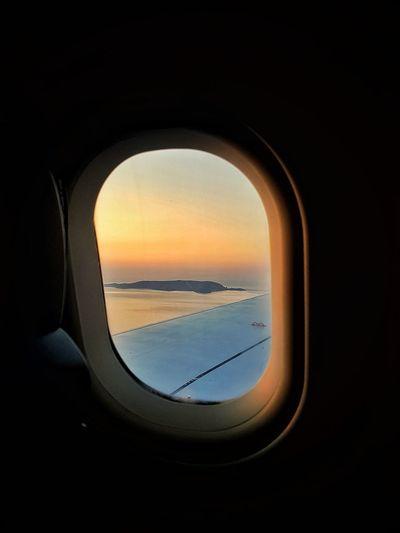 View of sea seen through airplane window