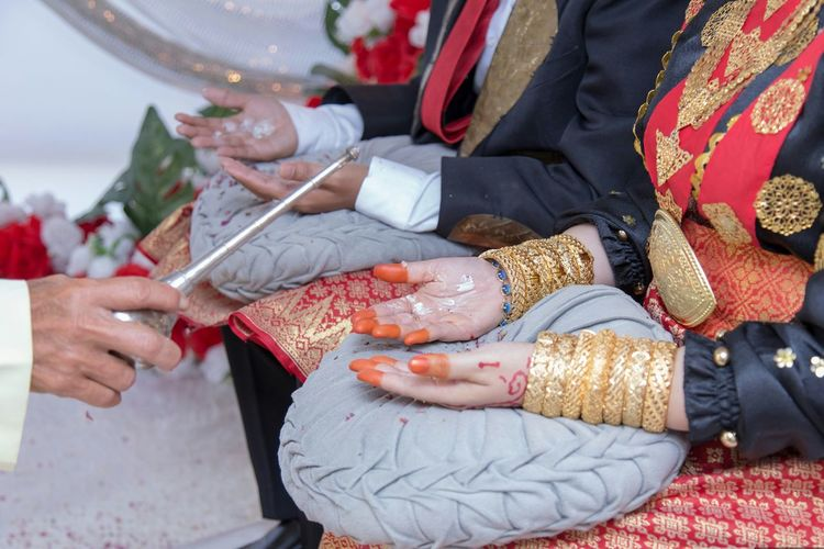 Tepung Tawar EyeEm Selects Human Hand Bridegroom Bride Wedding Dress Togetherness Ceremony Women Low Section Life Events Married Groom Henna Tattoo Traditional Culture Wedding Couple Wedding Ceremony Guest Engagement Ring Wedding Ring Wedding Vows Floral Garland Newlywed Finger Ring Traditional Ceremony Wedding Guest