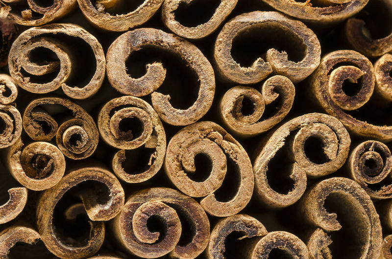Macro photography of the cinnamon sticks. Abstract background Backgrounds Full Frame No People Close-up Indoors  Design Pattern Rusty Shape Text Abundance Detail Textured  Still Life Letter Cinamon Stick - Plant Part Raw Food Plant Part Aromatherapy Dessert