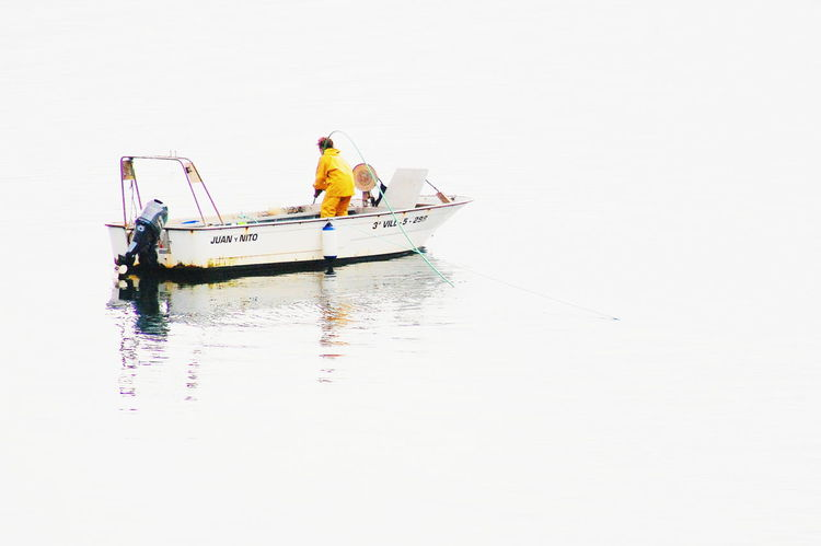 Showcase April Observing Fisherman Job Jobs Nature_collection Fisherboat Boat Boats⛵️ Water_collection Sea Yellow Reflections Lonely Alone Alone Time Solitary One One Person Calmness Calm