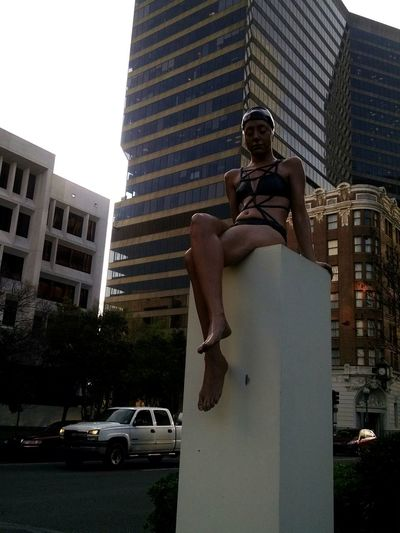Girl in swimsuit. Suprise. Lifelike sculpture. Downtown New Orleans. Art. Hi! Hanging Out Taking Photos New Orleans!!! Art& Artists Streetphotography Arquitecture Girlinswimsuit Seatingpreatty