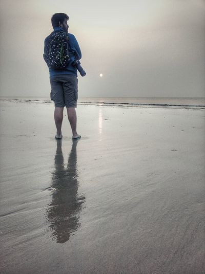 Reflection Beach Water Sea One Person Wet Horizon Over Water Casual Clothing Rain Sand Outdoors People Full Length Sky Adult Day One Man Only Nature Beachphotography Beach Life Beach Sunset Addidas Nikon Motorolaphotography