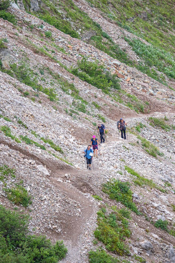 High angle view of people walking on mountain