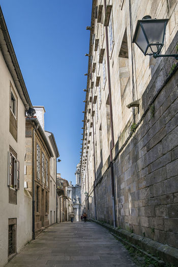 old town street and architecture of Santiago de Compostela in Galicia, Spain Architecture City Galicia, Spain Old Town Old Town Streets SPAIN Santiago De Compostela Spanish City Tourist Attraction  Architecture Building Exterior Built Structure Famous Place Street Sunny Day Urban