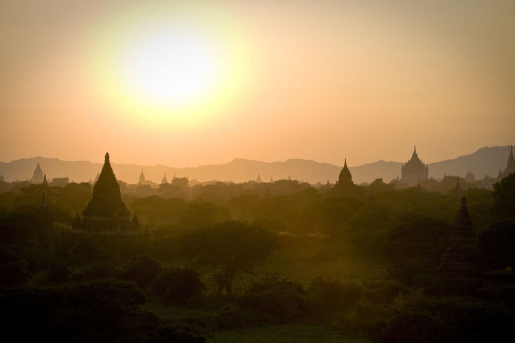 the valley of Bagan in Myanmar @sunshine Bagan Check This Out Checking In First Eyeem Photo Hill Idyllic Landscape Majestic Mountain Range Myanmar Nature No People Non Urban Scene Non-urban Scene Orange Color Outdoors Remote Scenics Showcase June Sun Sunset Tourism Tranquil Scene Tranquility Travel Destinations