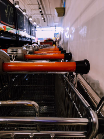 Shopping Cart Business Equipment Factory In A Row Indoors  Industry Large Group Of Objects Metal No People Orange Color Production Line Retail  Shopping Shopping Cart Technology
