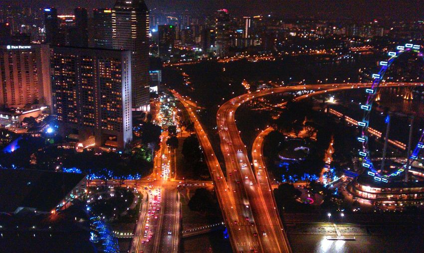 High Angle View Of Multiple Lane Highway And Illuminated Buildings In City
