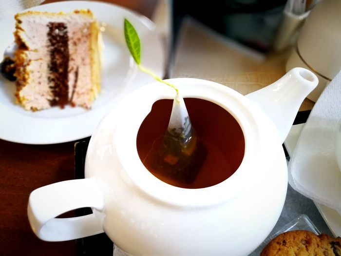 Cake Tea Tea Pot Mint Tea Mint Leaf - Culinary Tea Infuser Tea Time Tea Cup Table Design Food And Drink Drink Coffee - Drink Coffee Cup No People Indoors  Freshness Dessert Refreshment High Angle View Sweet Food Tea - Hot Drink Close-up Food Stories
