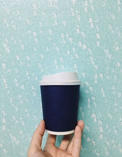 One Person Holding Human Hand Real People Hand Human Body Part Unrecognizable Person Personal Perspective Lifestyles Cup Wall - Building Feature Refreshment Body Part Drink Mug Indoors  Leisure Activity Food And Drink Finger Disposable Cup Take Away Coffee Paper Cup Blue Coffee Break Coffee Cup