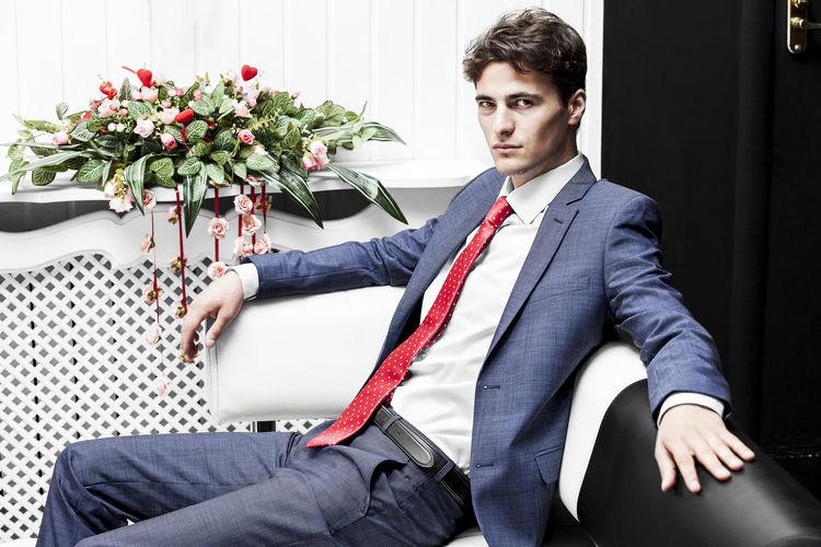 Portrait of businessman sitting on steps
