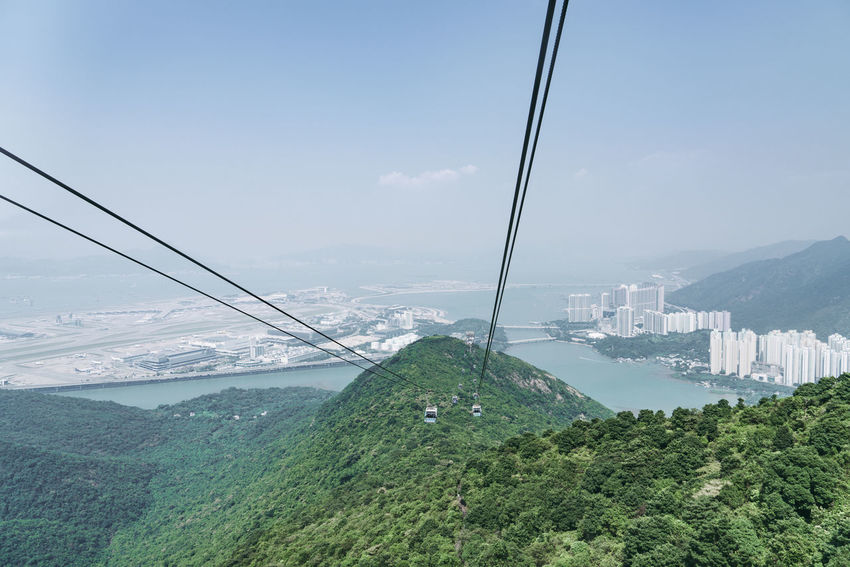 Architecture Beauty In Nature Bridge - Man Made Structure Built Structure Cable City Cityscape Connection Day Environment Green Color Landscape Mountain Nature No People Outdoors Overhead Cable Car Plant Scenics - Nature Sky Transportation Tree Water