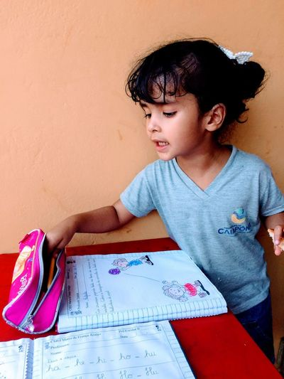 Cute girl studying on table