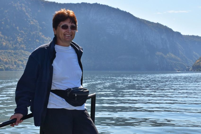 Danube gorge, Serbia Water One Person Real People Three Quarter Length Smiling Leisure Activity Front View Lifestyles Glasses Mountain Standing Beauty In Nature Nature Day Scenics - Nature Outdoors Mountain Range River Ship Fence