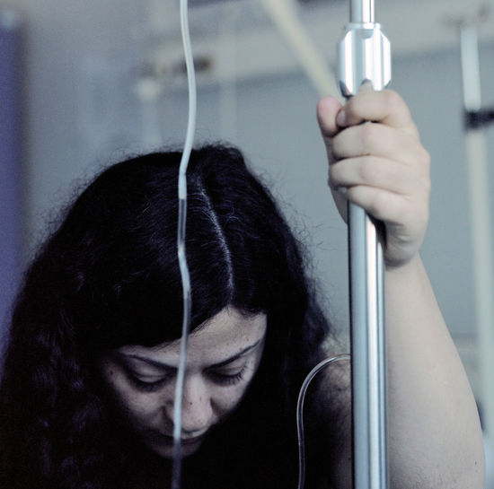 Close-up of woman by iv drip at hospital