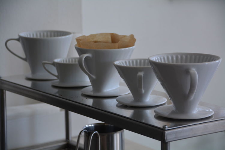 Different types of cups arranged in row