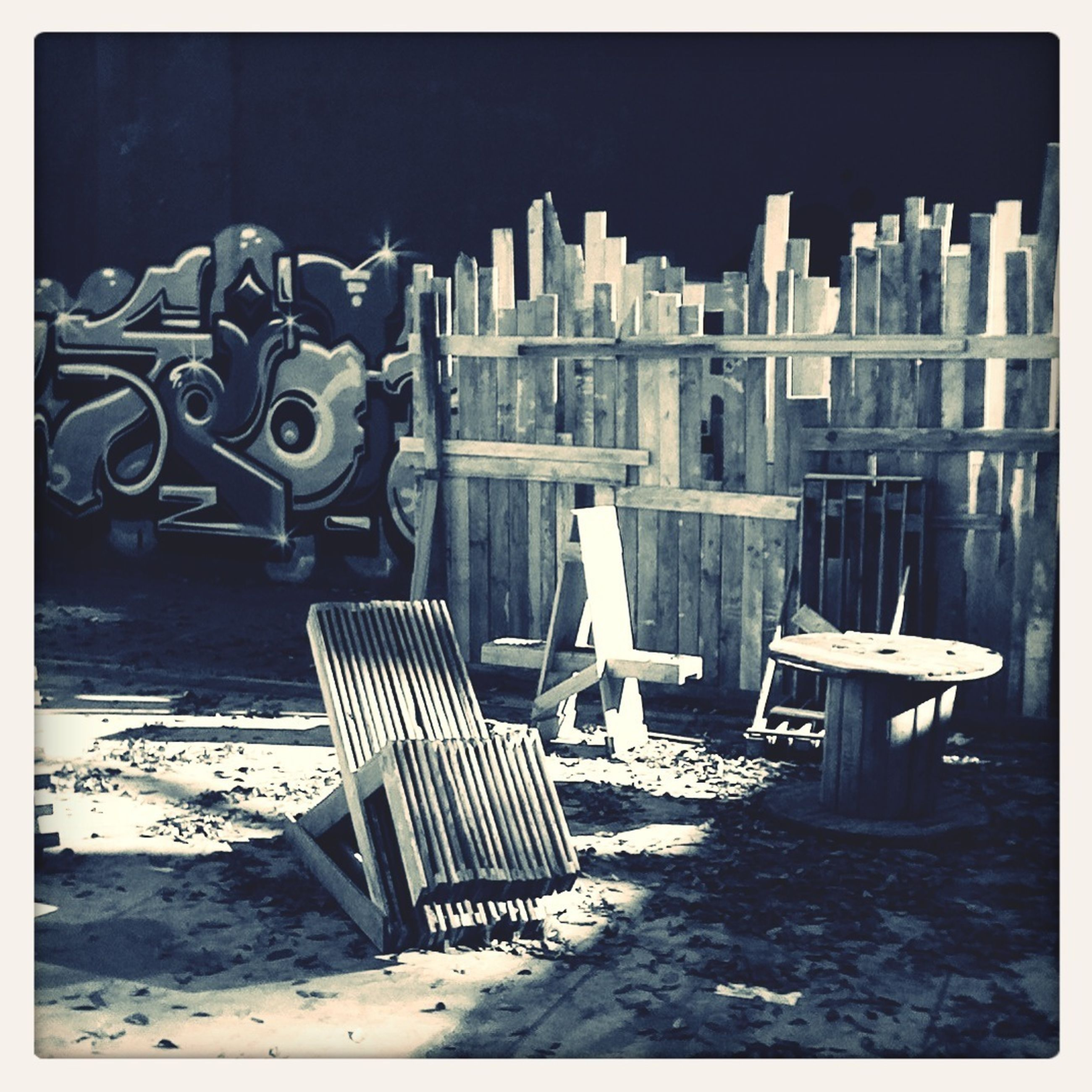 transfer print, auto post production filter, empty, chair, absence, built structure, sunlight, day, building exterior, architecture, outdoors, no people, table, in a row, shadow, arrangement, seat, water, city, wood - material